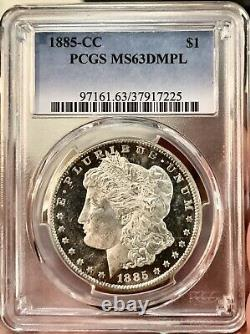 1885 CC Morgan Silver Dollar DMPL! MS63DMPLPCGSUDMCAMEOHARD STRIKE